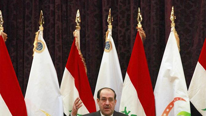 "Iraqi Prime Minister Nouri al-Maliki speaks to the press in Baghdad, Iraq, Friday, Dec. 28, 2012. Iraq's Prime Minister warned against a return to sectarian conflict and cautioned that the country is close to returning to the ""dark days when people were killed because of their names or identities.""(AP Photo/Hadi Mizban)"