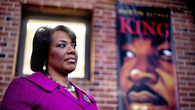 "In this Tuesday, Jan. 8, 2013 photo, Bernice King stands in the King Center next to a banner hanging in memory of her father, Dr. Martin Luther King Jr., in Atlanta. One of her father's quotes has been cited as one of America's essential ideals, its language suggestive of a constitutional amendment on equality: ""I have a dream that my four little children will one day live in a nation where they will not be judged by the color of their skin but by the content of their character."" Yet today, 50 years after the Rev. Martin Luther King Jr.'s monumental statement, there is considerable disagreement over what this quote means when it comes to affirmative action and other measures aimed at helping the disadvantaged. (AP Photo/David Goldman)"