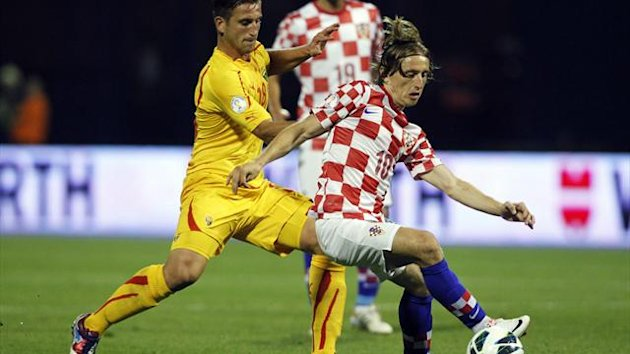 Croatia's Luka Modric is challenged by Macedonia's Muhamed Demiri during their 2014 World Cup qualifying game at Maksimir Stadium in Zagreb