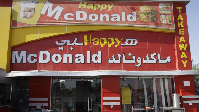 In this Saturday, Oct. 8, 2011 photo, a restaurant uses the trade name of McDonald's in Baghdad, Iraq. After more than eight years in Iraq, the departing American military's legacy includes a fledgling democracy, bitter memories of war, and for the nation's youth, rap music, tattoos and slang. (AP Photo/Karim Kadim)