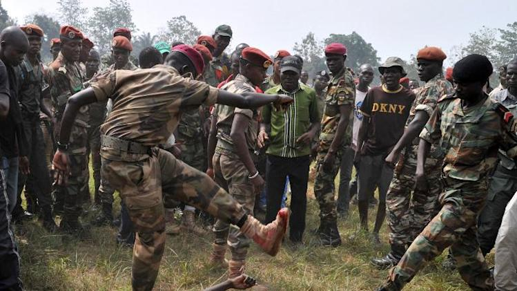 Members of the Central African Armed Forces (FACA) lynch to death a man suspected of being a former Seleka rebel on February 5, 2014, in Bangui