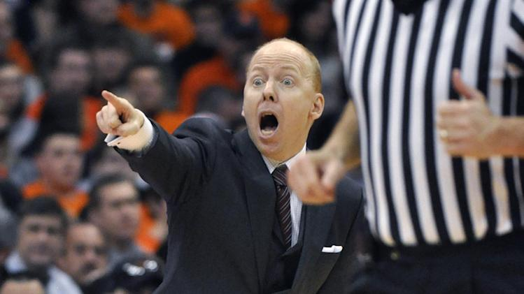 Cincinnati coach Mike Cronin yells to his players during the second half against Syracuse in an NCAA college basketball game in Syracuse, N.Y., Monday, Jan. 21, 2013. Syracuse won 57-55. (AP Photo/Kevin Rivoli)