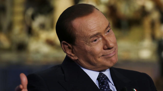 "Former Italian Premier and People of Freedom party Leader Silvio Berlusconi attends the recording of RAI (Italian State Television) TV talk show ""Porta a Porta""(Door to Door) hosted by journalist Bruno Vespa, in Rome, Tuesday, Dec. 18, 2012. Three times premier, Berlusconi insists Italy needs him and says voters soon will indicate if they are tired of him. The media mogul has flip-flopped in recent days on whether he'll run for the premiership in elections expected for February. Berlusconi resigned as premier in 2011 as Italy's debt crisis worsened, making way for economist Mario Monti to take the helm. (AP Photo/Gregorio Borgia)"