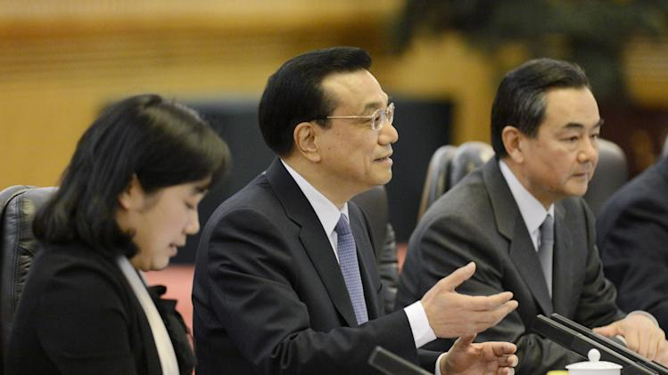 Chinese Premier Li Keqiang, center, talks with Iceland's Prime Minister Johanna Sigurdardottir, unseen, during a meeting at the Great Hall of the People in Beijing Monday, April 15, 2013. (AP Photo/Yohsuke Mizuno, Pool)