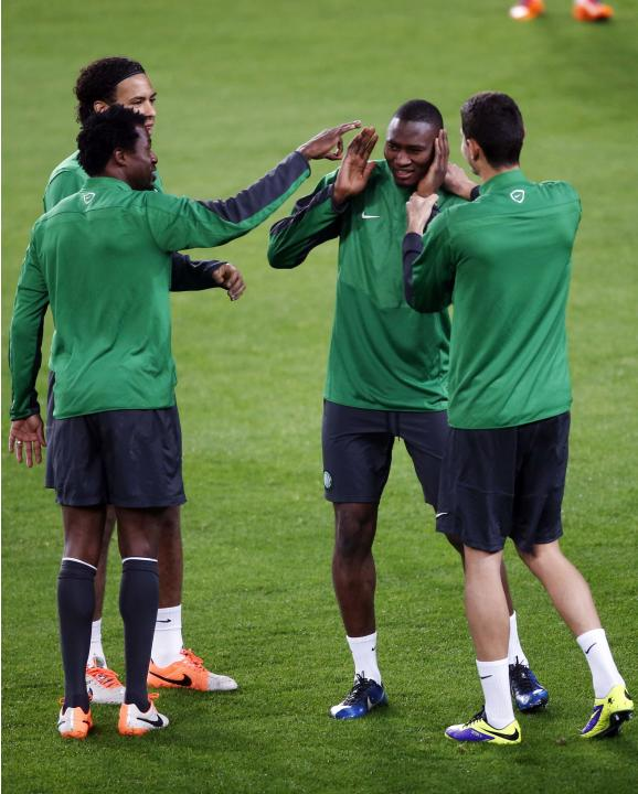 Celtic's player Amido Blade jokes with his teammates during a training session at Camp Nou stadium in Barcelona