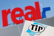 The logo of German supermarket chain &quot;Real&quot; pictured along with the logo of its own food brand &quot;TiP&quot; in Hamburg, northern Germany, on February 14, 2013. Germany&#39;s Real supermarket said tests on Wednesday had &quot;found traces of horsemeat&quot; adding there had been &quot;at no time evidence of a hygiene risk for consumers&quot;