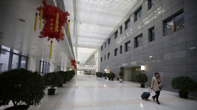 A woman walks inside the Peking Union Medical College Hospital on the eve of the Chinese Lunar New Year in Beijing