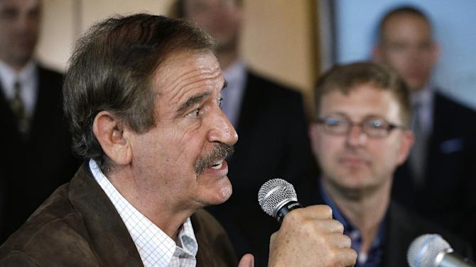 Former Mexican president Vicente Fox, left, speaks as Jamen Shively, CEO of Diego Pellicer, looks on during a news conference Thursday, May 30, 2013, in Seattle. Diego Pellicer Inc. announced recent acquisitions of medical marijuana dispensary chains in Washington and Colorado, creating the first national brand of retail cannabis. Diego also spoke about plans to expand across the United States and internationally, and to become the market leader in both medical and adult-use marijuana. (AP Photo/Elaine Thompson)