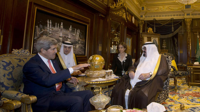"""U.S. Secretary of State John Kerry meets with Saudi Arabia's King Abdullah, right, in Riyadh, Monday, Nov. 4, 2013. Seeking to bridge multiple policy rifts with Saudi Arabia, Kerry hailed the kingdom's role as """"the senior player"""" in the Middle East on Monday. Speaking to employees at the U.S. Embassy in Riyadh ahead of meetings with Saudi Arabia's king and foreign minister, Kerry said Saudi Arabia had assumed the Arab leadership mantle from Egypt, which is currently distracted by major domestic uncertainty. He said strengthening the U.S.-Saudi partnership is critical to Mideast security and stability and cementing tentative political transitions around the region. (AP Photo/Jason Reed, Pool)"""