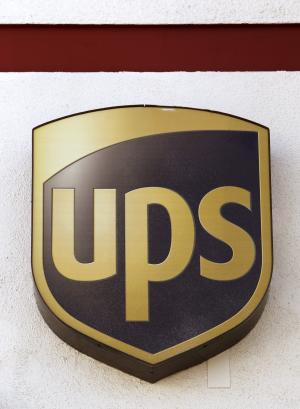 FILE - This Jan. 30, 2012, file photo, shows a UPS logo at a UPS store in the Lake Balboa area of Los Angeles. United Parcel Service Inc., said Thursday, April 26, 2012, that net income rose to $970 million, or $1 per share, from $915 million, or 91 cents per share. Revenue rose 4.4 percent to $13.14 billion. (AP Photo/Damian Dovarganes, File)