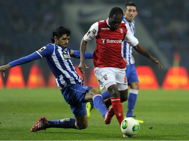 FC Porto's Lucho Gonzalez, left, from Argentina tackles Sporting Braga's Luiz Carlos, from Brazil, in a Portuguese League soccer match at the Dragao Stadium in Porto, Portugal, Saturday, Dec.