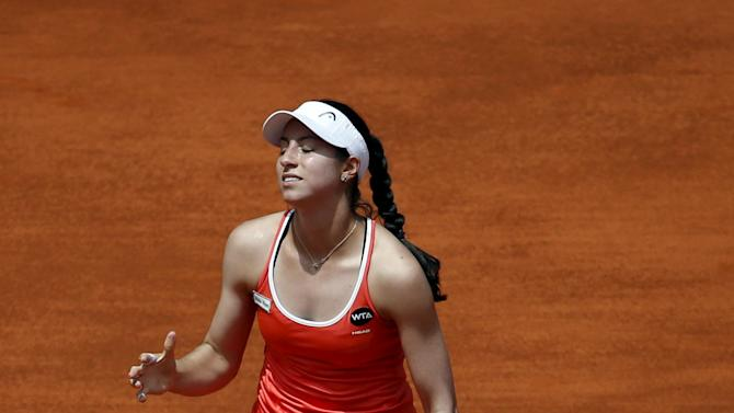 McHale of the U.S. reacts after losing a point to Wozniaki of Denmark during their match at the Madrid Open tennis tournament in Madrid