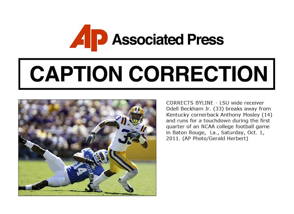 CORRECTS BYLINE - LSU wide receiver Odell Beckham Jr. (33) breaks away from Kentucky cornerback Anthony Mosley (14) and runs for a touchdown during the first quarter of an NCAA college football game in Baton Rouge,  La., Saturday, Oct. 1, 2011. (AP Photo/Gerald Herbert)