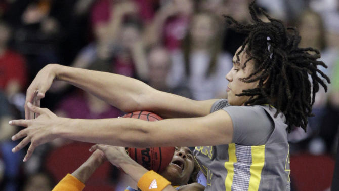FILE - This March 26, 2012 file photo shows Tennessee's Meighan Simmons, left, being fouled by Baylor's Brittney Griner during the second half of an NCAA women's college basketball tournament regional final in Des Moines, Iowa. Griner is getting ready for her senior season at Baylor, which is coming off the NCAA's first 40-win season. (AP Photo/Charlie Neibergall, File)