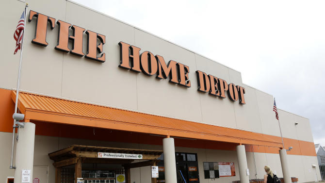 FILE - In a Tuesday, Aug. 14, 2012, file photo, aperson walks toward a Home Depot in Nashville, Tenn.  Home Depot's fiscal fourth-quarter net income surged 32 percent, the home improvement retailer said Tuesday Feb. 26, 2013.   (AP Photo/Mark Humphrey, File)