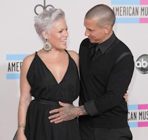 Carey Hart pats wife Pink's pregnant tummy at the 2010 American Music Awards held at Nokia Theatre L.A. Live in Los Angeles on November 21, 2010 -- Getty Premium