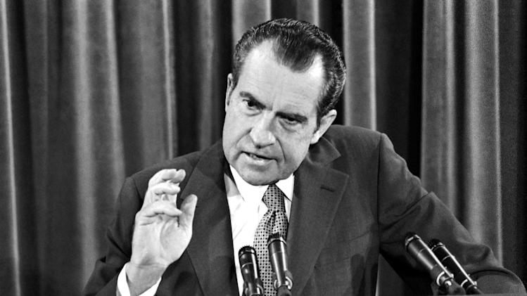"In this June 29, 1972, file photo, President Richard Nixon gestures during his news conference in Washington. As Barack Obama arrives in Israel for his first trip there as president, a 1972 recording shows that Nixon complained of the Democrats' ""dishonest"" platform language _ declaring Jerusalem the capital of Israel. On the previously unreported taped conversation, Nixon suggested that Democratic military cuts would leave Israel vulnerable to military aggression. Israel had fought a war against its Arab neighbors five years earlier.  (AP Photo/File)"