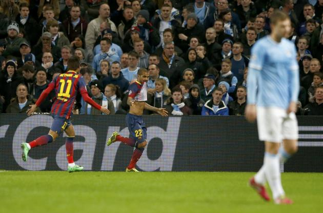 Barcelona's Dani Alves celebrates after scoring Barcelona's second goal against Manchester City during their Champions League round of 16 first leg soccer match at the Etihad Stadium in Manche