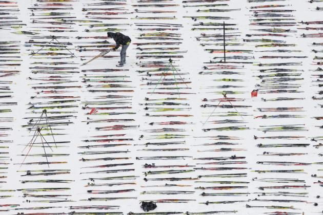 A man prepares skis for the annual Engadine cross country skiing marathon from Maloja to S-Chanf in south Eastern Switzerland, Sunday, March 13, 2011.  Around 12,000 sportsmen and women participated i