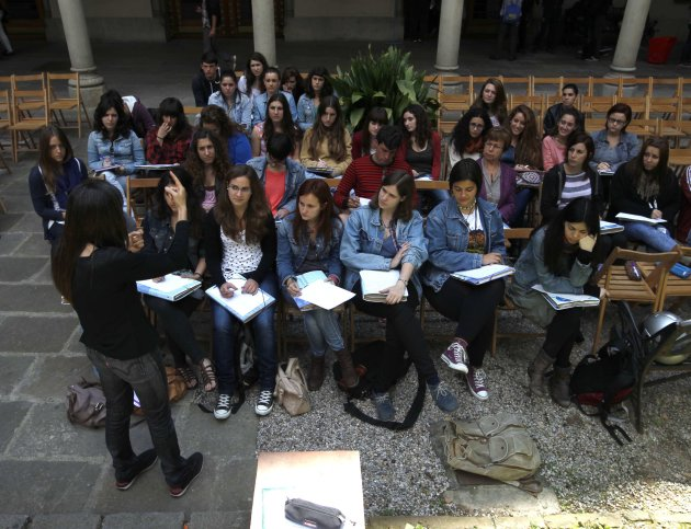 Students attend a class in the gardens of the University of Barcelona during a protest day in Barcelona