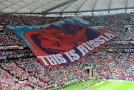 Russia&#39;s football fans display a giant banner during the Euro 2012 championships football match Poland vs Russia on June 12 at the National Stadium in Warsaw
