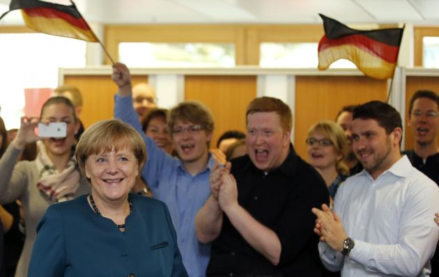 Triumphant Merkel seeks coalition