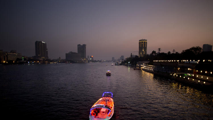 Boats travel on the Nile River in Cairo, Egypt, Wednesday, Nov. 7, 2012. (AP Photo/Bernat Armangue)