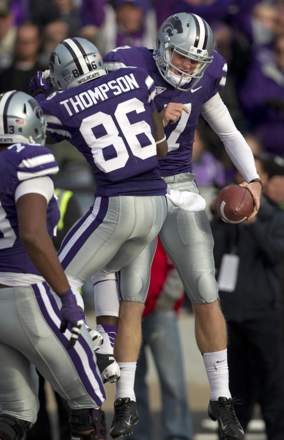 Kansas State quarterback Collin Klein (7) celebrates a touchdown with wide receiver Tramaine Thompson (86) during the second half of an NCAA college football game against Texas Tech in Manhattan, Kan., Saturday, Oct. 27, 2012. (AP Photo/Orlin Wagner)
