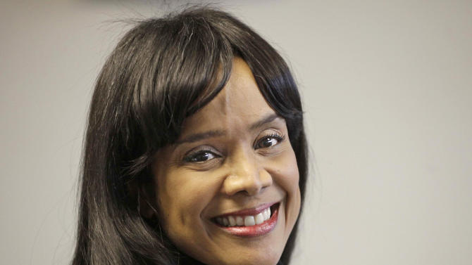FILE - This Feb. 16, 2011 file photo shows Chicago Alderman Sandi Jackson, wife of former Illinois Rep. Jesse Jackson Jr., in her Chicago office, who has resigned from the Chicago City Council. Rep. Jesse Jackson Jr. resigned from Congress in November. (AP Photo/M. Spencer Green, File)