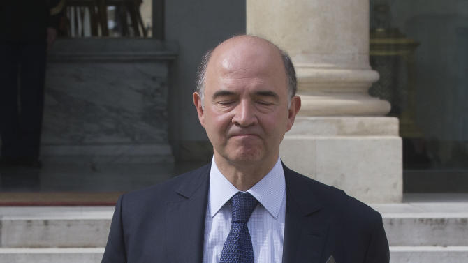 French Finance Minister Pierre Moscovici, reacts as he walks toward the media after the weekly cabinet meeting in Paris, Wednesday, May 15, 2013. The French national statistics agency, Insee, said Wednesday that gross domestic product fell 0.2 per cent in the first quarter of the year, effectively moving France back into recession, and with eurozone's second-largest economy, the French economy is likely to exacerbate problems throughout the euro region.(AP Photo / Michel Euler)