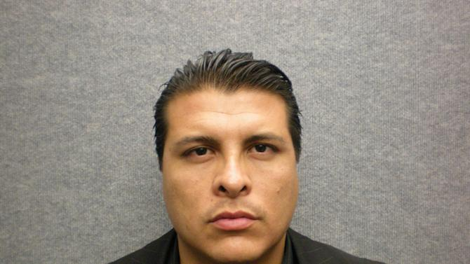 This photo provided by the Orange Police Department shows the undated booking photo for Shazer Fernando Limas, 31, who was arrested early Friday May 4, 2012 following the chase on Interstate 5. He is suspected of killing his girlfriend, Arlet Hernandez Contreras, 31, and the couple's two young boys. (AP Photo/Orange Police Department)