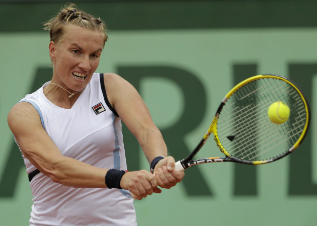 Russia's Svetlana Kuznetsova returns the ball to Poland's Agnieszka Radwanska during their third round match in the French Open tennis tournament at the Roland Garros stadium in Paris, Friday, June 1,