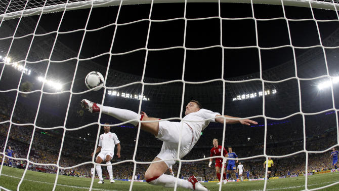 FILE - In this June 19, 2012 filer, England's John Terry clears the ball away from his goal during the Euro 2012 soccer championship Group D match between England and Ukraine in Donetsk, Ukraine. UEFA has called on FIFA's law-making panel to delay a decision on approving goal line technology next week. The European football body also pledged full support Saturday for its rival five-officials method of refereeing promoted by its president Michel Platini, despite an obvious error which denied Ukraine a goal in a decisive European Championship group match against England. (AP Photo/Matthias Schrader, File)