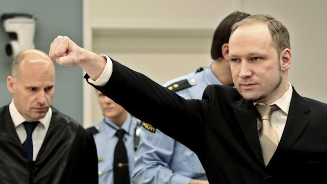 FILE -In this Monday, April 16, 2012, file photo, accused Norwegian Anders Behring Breivik gestures as he arrives at the courtroom, in Oslo, Norway. Causes across the political spectrum have long used distinctive salutes to identify themselves. Breivik, the far-right suspect in the massacre of 77 people in Norway, is hardly the first to flash such a salute. (AP Photo/Hakon Mosvold Larsen, Pool, File )