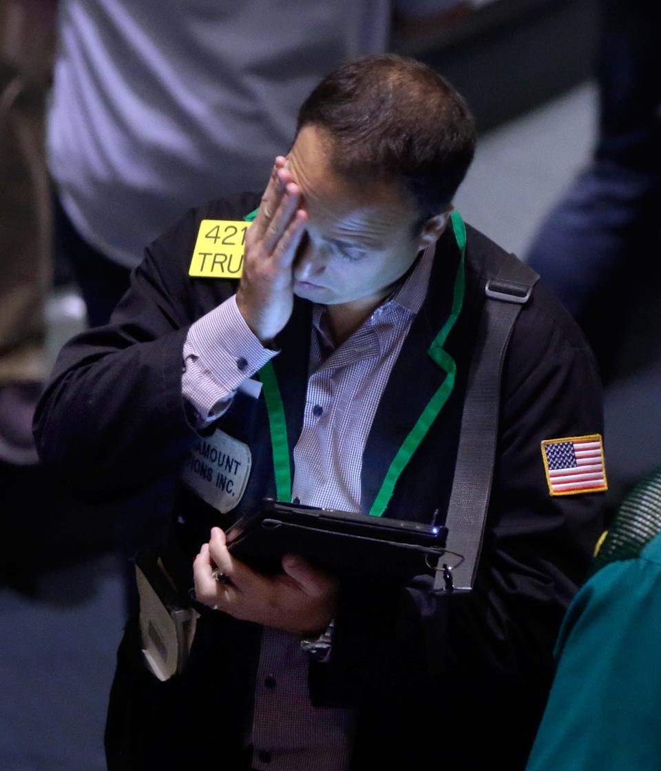 A trader works in the oil options pit at the New York Mercantile Exchange, Wednesday, July 3, 2013. Oil climbed above $101 a barrel as the political crisis in Egypt intensified. (AP Photo/Richard Drew)