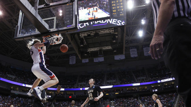 Gonzaga's  Kelly Olynyk dunks against Wichita State in the first half during a third-round game in the NCAA men's college basketball tournament in Salt Lake City on Saturday, March 23, 2013. (AP Photo/George Frey)