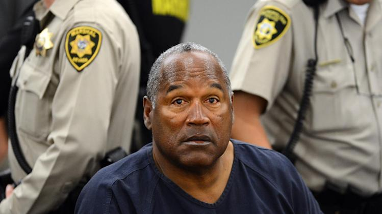 O.J. Simpson sits during a break appears during a break on the second day of  an evidentiary hearing in Clark County District Court, Tuesday, May 14, 2013 in Las Vegas.  The hearing is aimed at proving Simpson's trial lawyer, Yale Galanter,  had conflicted interests and shouldn't have handled Simpson's case. Simpson is serving nine to 33 years in prison for his 2008 conviction in the armed robbery of two sports memorabilia dealers in a Las Vegas hotel room. (AP Photo/Ethan Miller, Pool)