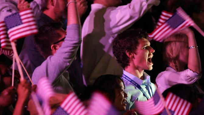 Supporters cheer as they wait for President Barack Obama at his election night party Wednesday, Nov. 7, 2012, in Chicago. President Obama defeated Republican challenger former Massachusetts Gov. Mitt Romney. (AP Photo/Pablo Martinez Monsivais)