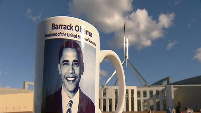 "This June 7, 2010 image from television supplied by Network 10 shows a commemorative coffee mug of the 2010 presidential visit by Barack Obama sitting on a stone pillar in front of Parliament House in Canberra, Australia. A Parliament House official told senators on Monday, May 21, 2012 that 198 mugs were smashed and buried under wet concrete at a loading dock behind the building. One senator called it a ""mafia-style execution"" for the mugs, which had an extra ""r"" printed in Obama's first name.  (AP Photo/Network 10) AUSTRALIA OUT"