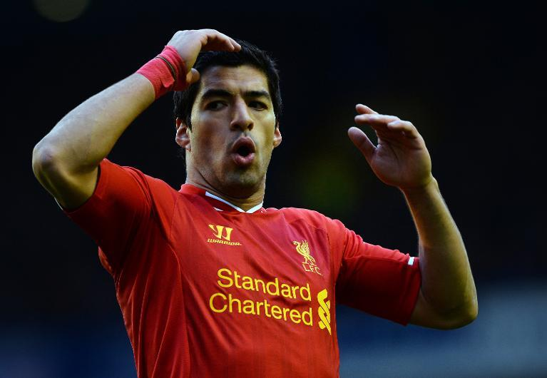 Liverpool striker Luis Suarez reacts to a missed opportunity during an English Premier League match against Everton at Liverpool's Goodison Park on November 23, 2013