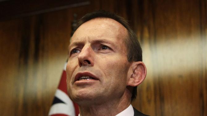 File photo of Australian opposition leader Abbott addressing a news conference in central Sydney