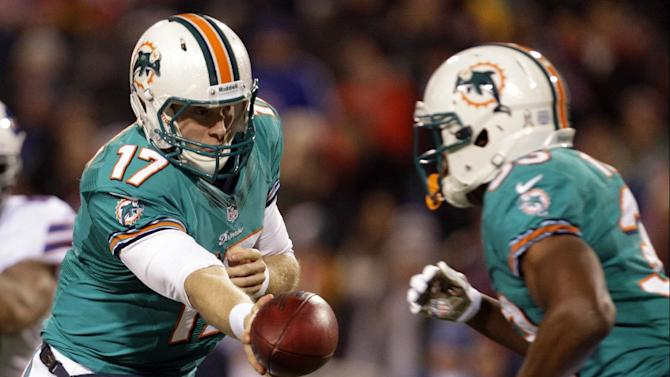 Miami Dolphins quarterback Ryan Tannehill (17) hands off the ball to teammate Daniel Thomas (33) during the first half of an NFL football game against the Buffalo Bills, Thursday, Nov. 15, 2012, in Orchard Park, N.Y. (AP Photo/Gary Wiepert)