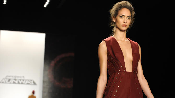 """Fashion by the finalists of  """"The Project Runway"""" fashion competition series is modeled during Fashion Week, Friday Feb. 8, 2013, in New York. (AP Photo/Louis Lanzano)"""