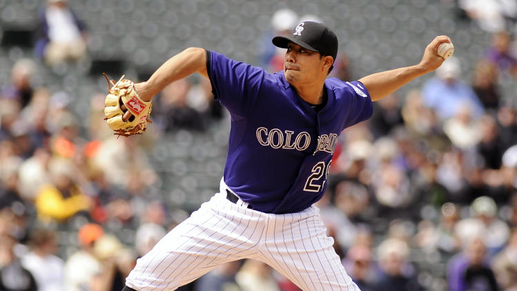 Colorado Rockies pitcher Jorge De La Rosa throws in the first inning of a baseball game against the San Francisco Giants at Coors Field in Denver on Wednesday, April 20, 2011. (AP Photo/Chris Schneider)