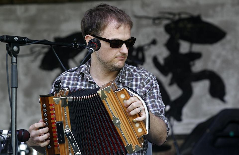 Cajun accordion player Drew Simon of the band T'Monde, plays at  the Fais Do Do Stage during the New Orleans Jazz and Heritage Festival in New Orleans, Friday, April 26, 2013. The Cajun band opened the annual festival. (AP Photo/Doug Parker)