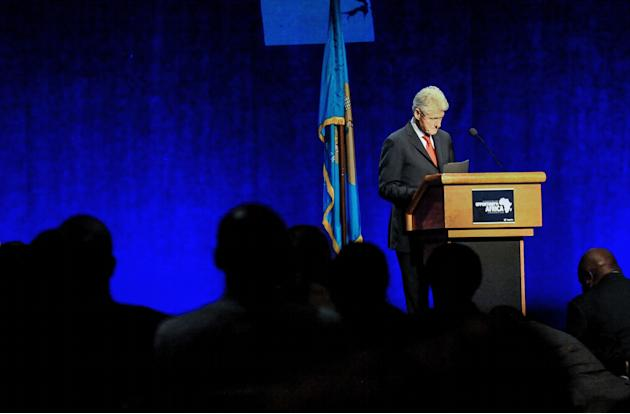 The audience rises to applaud Former President Bill Clinton after he delivered remarks at the Opportunity: Africa conference in Wilmington, Del., Monday, March 10, 2014. The conference, hosted by Sen.