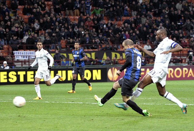 Inter Milan's Palacio shoots to score his team's second goal against Tottenham Hotspur during their Europa League soccer match in Milan