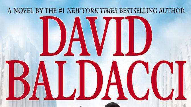 """This book cover image released by Grand Central Publishing shows """"The Hit,"""" by David Baldacci. (AP Photo/Grand Central Publishing)"""