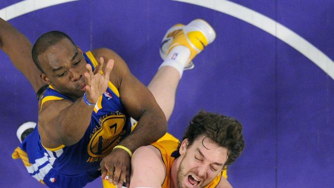 Los Angeles Lakers forward Pau Gasoll, center, of Spain, puts up a shot as Golden State Warriors guard Jarrett Jack, below, and forward Carl Landry defend during the first half of their NBA basketball game, Friday, April 12, 2013, in Los Angeles. (AP Photo/Mark J. Terrill)