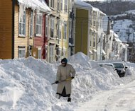 A woman shovels out after a winter storm hit St.John's. N.L., Sunday, Jan.5, 2014. THE CANADIAN PRESS/Paul Daly